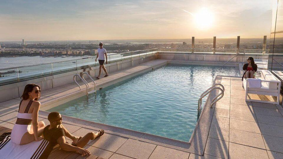 Tenants in 555TEN can take a dip in a 15-by-43-foot saltwater plunge pool.